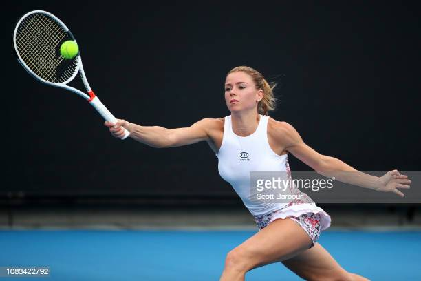 Camila Giorgi of Italy plays a forehand in her second round match against Iga Swiatek of Poland during day four of the 2019 Australian Open at...