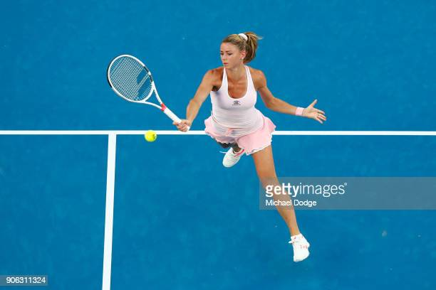 Camila Giorgi of Italy plays a forehand in her second round match against Ashleigh Barty of Australia on day four of the 2018 Australian Open at...