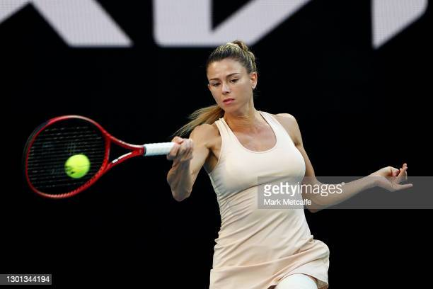 Camila Giorgi of Italy plays a forehand in her Women's Singles second round match against Iga Swiatek of Poland during day three of the 2021...