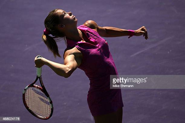 Camila Giorgi of Italy plays a match against Simona Halep of Romania during Day 7 of the Miami Open presented by Itau at Crandon Park Tennis Center...