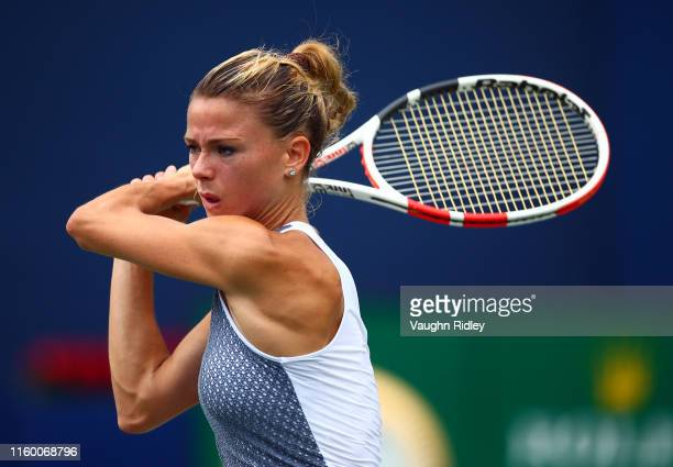 Camila Giorgi of Italy plays a shot against Victoria Azarenka of Belarus during a first round match on Day 4 of the Rogers Cup at Aviva Centre on...
