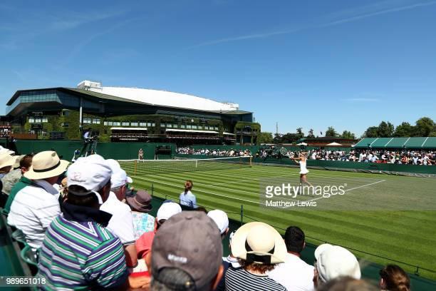 Camila Giorgi of Italy plays against Anastasija Sevastova of Latvia during their Ladies' Singles first round match on day one of the Wimbledon Lawn...