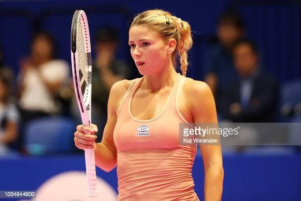 Camila Giorgi of Italy reacts during her singles first round match against Misaki Doi of Japan on day one of the Toray Pan Pacific Open at Arena...