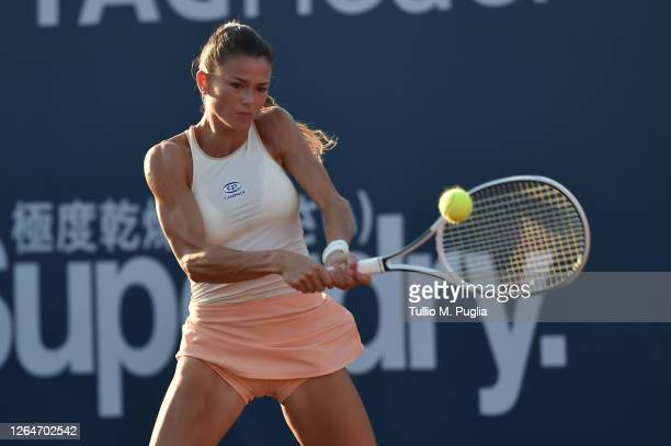 Camila Giorgi of Italy returns a shot against Fiona Ferro of France during 31st Palermo Ladies Open Semi Finals on August 08, 2020 in Palermo, Italy.