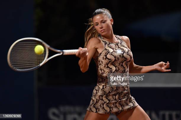 Camila Giorgi of Italy returns a shot against Rebecca Peterson of Sweden during the 31st Palermo Ladies Open - Day Two on August 04, 2020 in Palermo,...