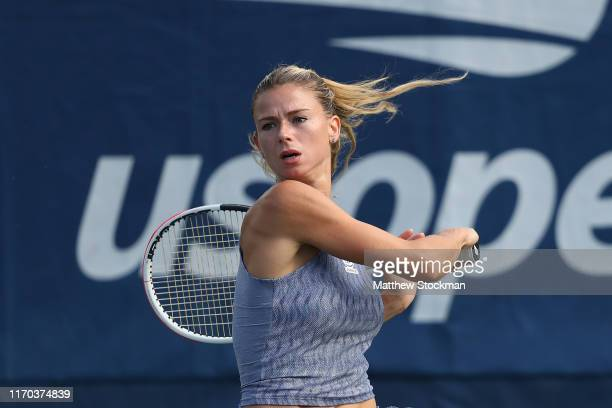 Camila Giorgi of Italy returns a shot during her Women's Singles first round match against Maria Sakkari of Greece during day one of the 2019 US Open...