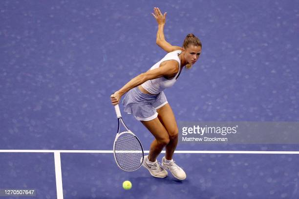 Camila Giorgi of Italy returns a volley during her Women's Singles second round match against Naomi Osaka of Japan on Day Three of the 2020 US Open...