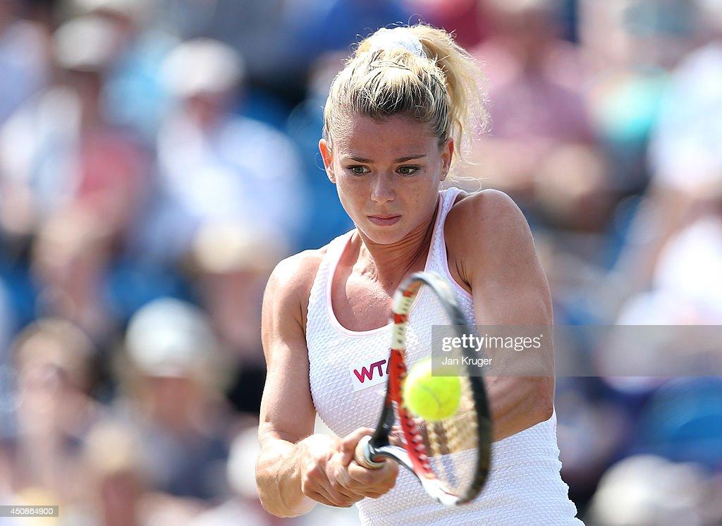 Camila Giorgi of Italy returns against Caroline Wozniacki of Denmark during their singles match on day six of the Aegon International at Devonshire Park on June 19, 2014 in Eastbourne, England.