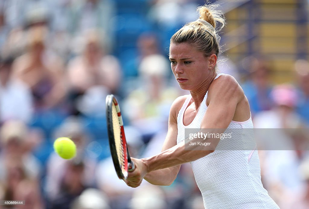 Camila Giorgi of Italy returns against Caroline Wozniacki of Denmark during their singles match on day six of the Aegon International at Devonshire Park on June 19, 2014 in Eastbourne, England.