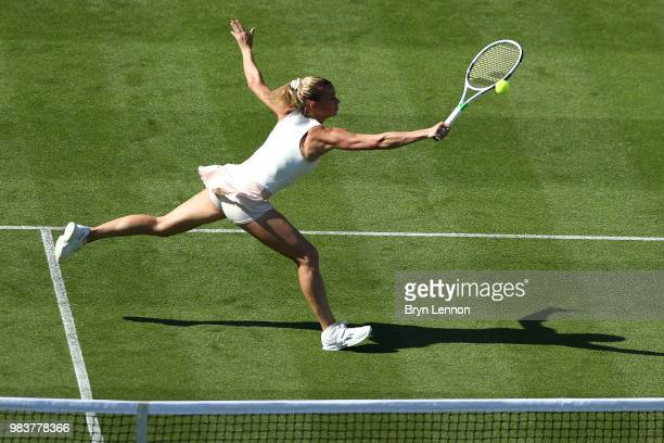 Camila Giorgi of Italy returns against Denmark's Caroline Wozniacki during her first round match on day four of the Nature Valley International at...
