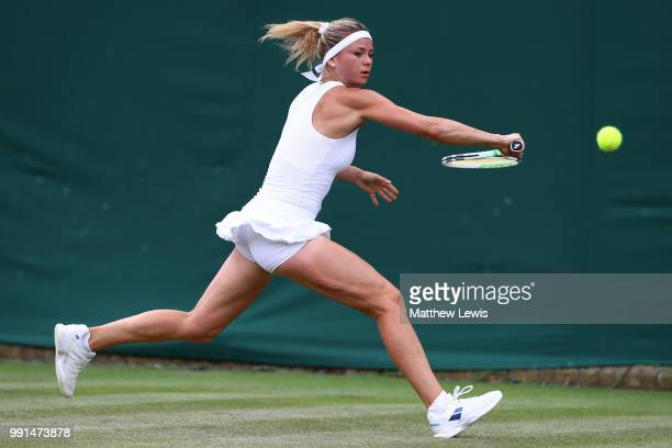 Camila Giorgi of Italy returns against Madison Brengle of the United States during their Ladies' Singles second round match on day three of the...