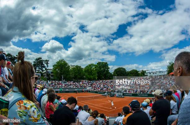 Camila Giorgi of Italy returns the ball to Sloane Stephens of United States during the third round at Roland Garros Grand Slam Tournament Day 7 on...