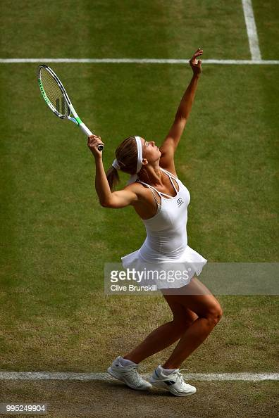 Camila Giorgi of Italy serves against Serena Williams of the United States during their Ladies' Singles QuarterFinals match on day eight of the...