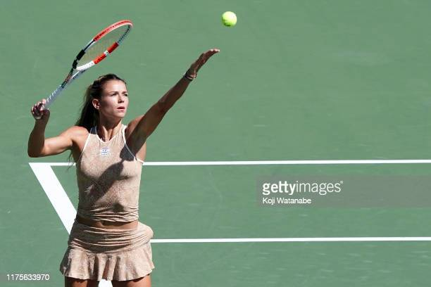 Camila Giorgi of Italy serves against Sloane Stephens of the United States during day four of the Toray Pan Pacific Open at Utsubo Tennis Cent on...