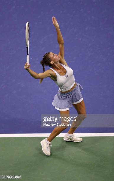 Camila Giorgi of Italy serves during her Women's Singles second round match against Naomi Osaka of Japan on Day Three of the 2020 US Open at the USTA...
