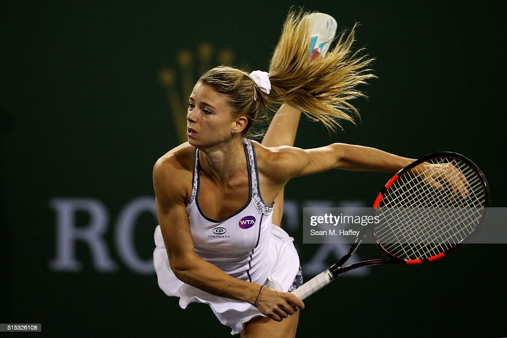Camila Giorgi of Italy serves to Ana Ivanovic of Serbia during the BNP Paribas Open at the Indian Wells Tennis Garden on March 11 at Indian Wells Tennis Garden on March 12, 2016 in Indian Wells, California