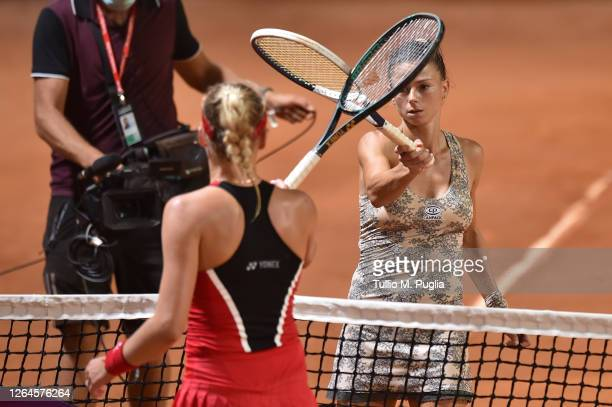 Camila Giorgi of Italy touches racket with Dayana Yastremska of Ukraine after winning the match during 31st Palermo Ladies Open Quarter Finals on...