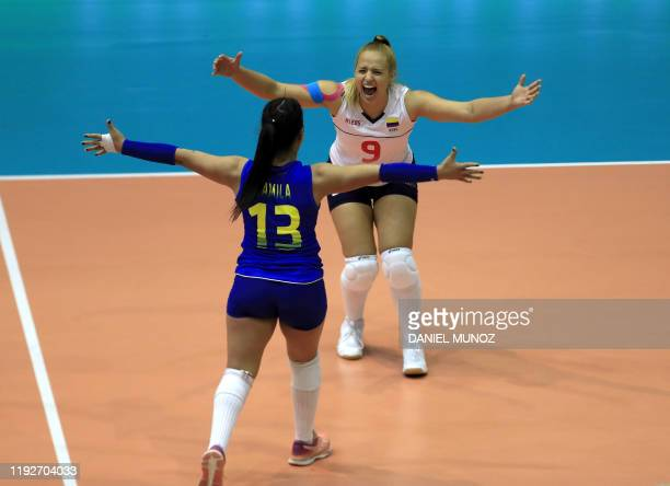 Camila Gomez and Juliana Toro of Colombia react after defeating Peru during their women's Tokyo 2020 Olympics Qualification match in Bogota on...