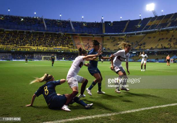 Camila Gomez Ares and Cecilia Gigho of Boca Juniors competes for the ball with Vanina Garcia Cueva and Candelaria D´Andrea of Lanus during a match...