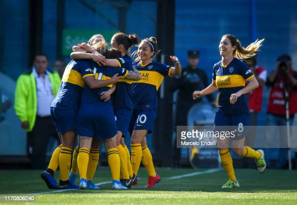 Camila Gomez Ares of Boca Juniors celebrates after scoring the second goal of her team with teammtes during a match between Boca Juniors and River...