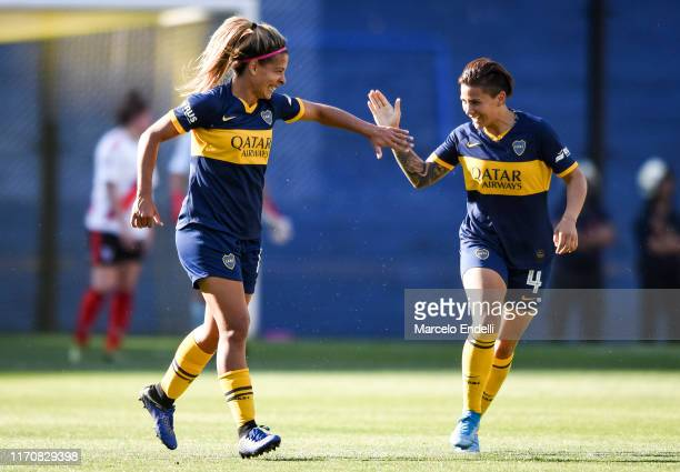 Camila Gomez Ares of Boca Juniors celebrates with teammate after scoring the fourth goal of his team during a match between Boca Juniors and River...