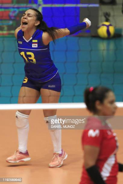 Camila Gomez of Colombia celebrates a point against Peru during their women's Tokyo 2020 Volleyball Qualification match in Bogota on January 8 2020