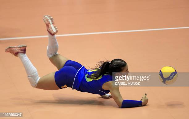 TOPSHOT Camila Gomez of Colombia dives for a ball during the women's Tokyo 2020 Volleyball Qualification match against Peru in Bogota on January 8...