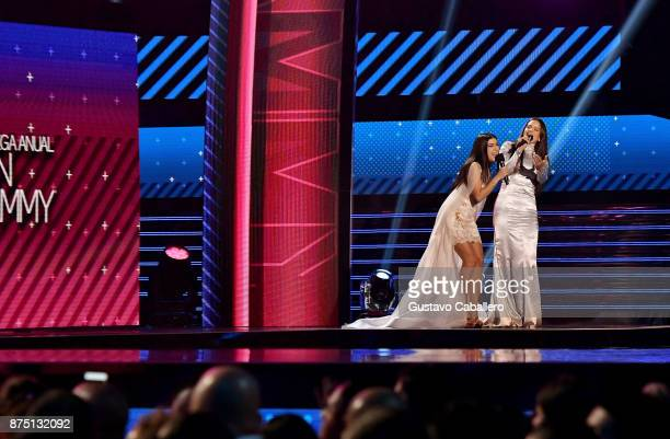 Camila Luna and Rosalia speak onstage during The 18th Annual Latin Grammy Awards at MGM Grand Garden Arena on November 16 2017 in Las Vegas Nevada