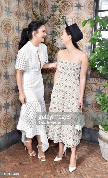 Camila Mendes and Hong Chau wearing Dior attend Lynn Hirschberg Celebrates W Magazine's It Girls With Dior at AOC on January 6 2018 in Los Angeles...