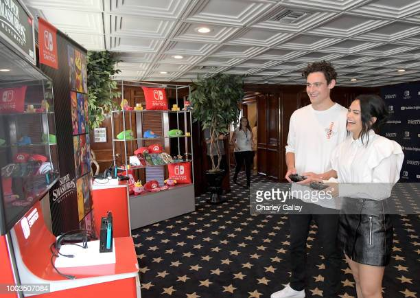 Camila Mendes and Victor Houston test their skills on Super Smash Bros Ultimate for Nintendo Switch at the Variety Studio at ComicCon 2018 on July 21...