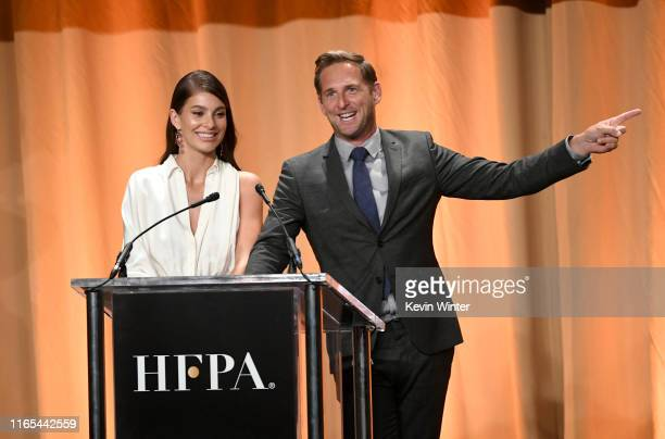 Camila Morrone and Josh Lucas speak onstage during Hollywood Foreign Press Association's Annual Grants Banquet at Regent Beverly Wilshire Hotel on...
