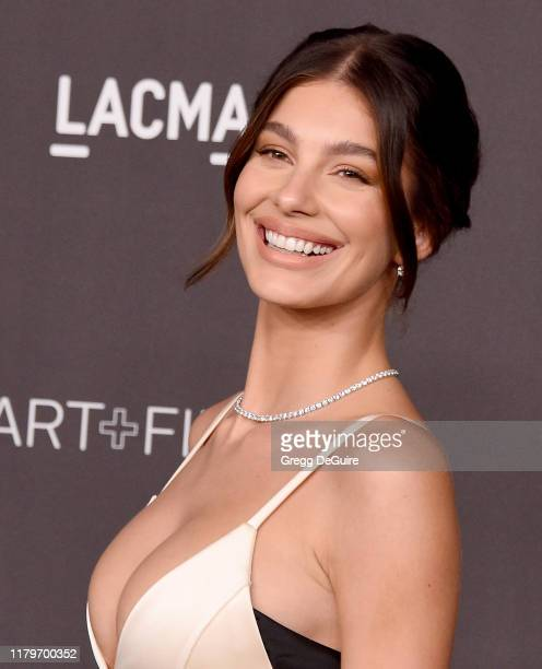Camila Morrone arrives at the 2019 LACMA Art Film Gala Presented By Gucci on November 2 2019 in Los Angeles California