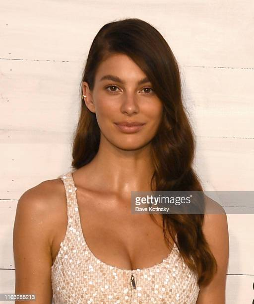 Camila Morrone wears a beige and white fantasy tweed dress Look 44 from the SpringSummer 2019 ReadytoWear Collection CHANEL Shoes accessories and bag...