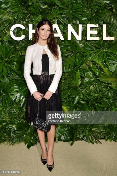 Camila Morrone wearing CHANEL attends Chanel Dinner Celebrating Gabrielle Chanel Essence With Margot Robbie on September 12 2019 in Los Angeles...