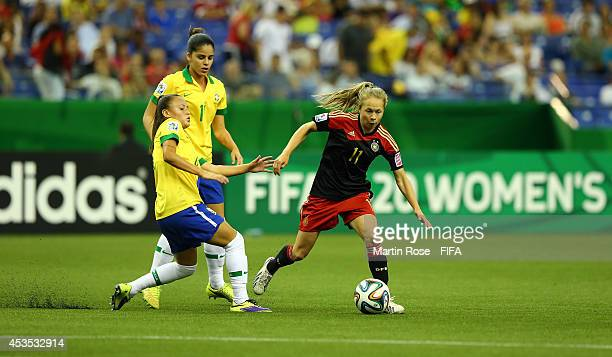 Camila of Brazil and Theresa Panfil of Germany battle for the ball during the FIFA U20 Women's World Cup 2014 group B match between Brazil and...