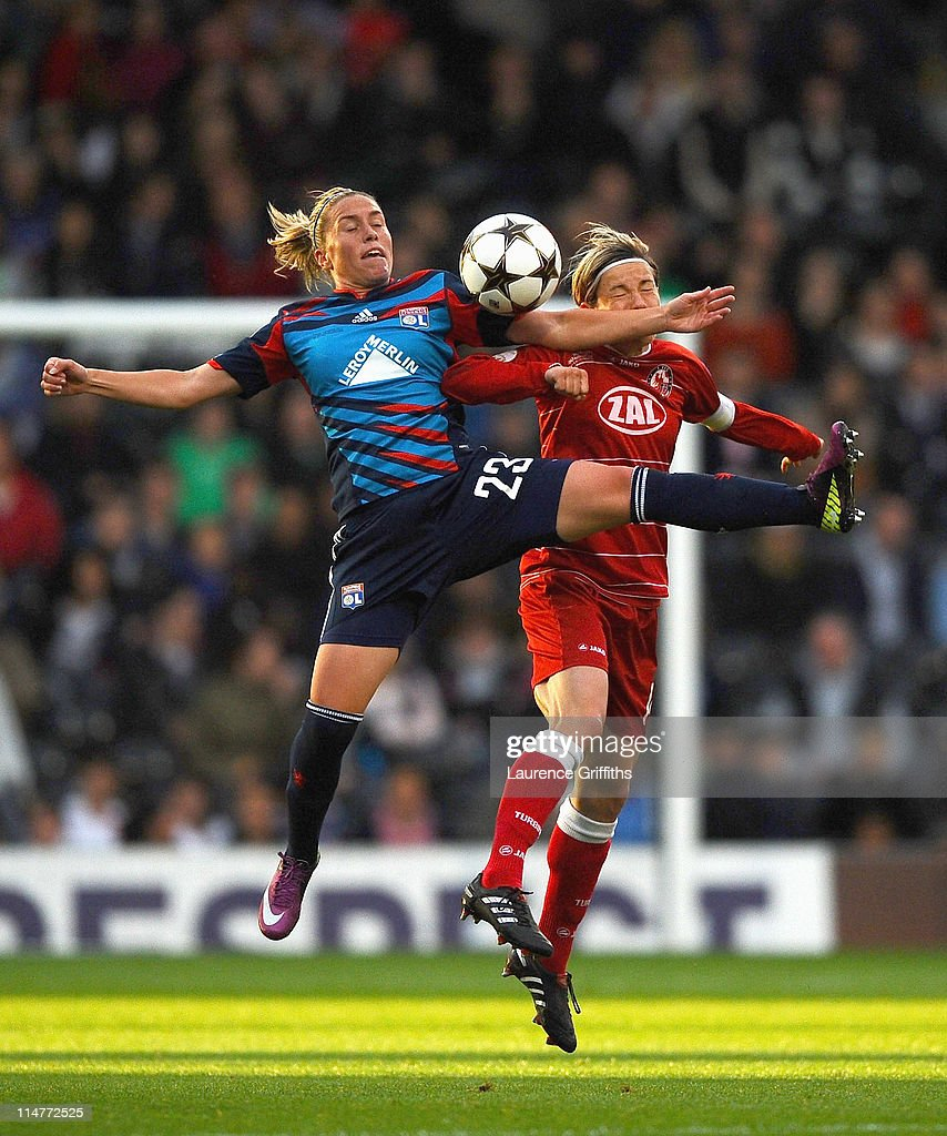 Camile Abily of Lyon battles with Jennifer Zietz of Turbine Potsdam during the UEFA Women's Champions League Final between Lyon and Turbine Potsdam at Craven Cottage on May 26, 2011 in London, England.