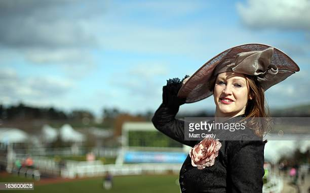 Camilla BassettSmith poses for a photograph as she arrives for Ladies Day at Cheltenham Racecourse on the second day of the Cheltenham Festival 2013...