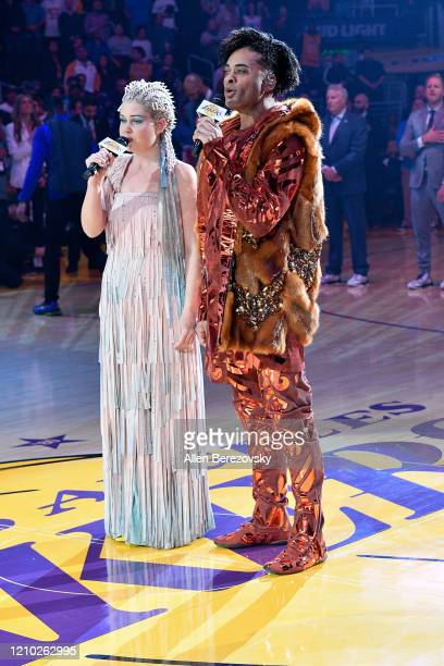 Camilla Blackman and Eric Deshan of Cirque du Soleil Volta sing the national anthem prior to a basketball game between the Los Angeles Lakers and the...