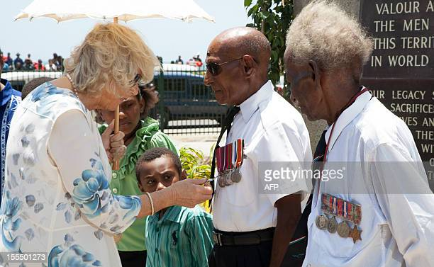 Camilla Britain's Duchess of Cornwall inspects the medals on Papua New Guinea veterans known as 'Fuzzy Wuzzy Angels' who helped carry supplies and...