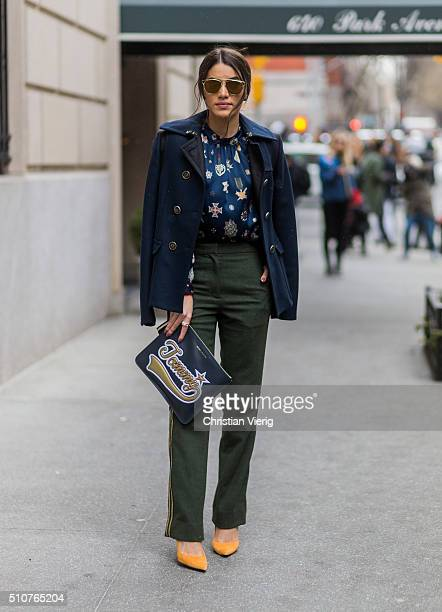 Camilla Coelhowearing a blue wool jacket and olive pants and a Tommy Hilfiger clutch seen outside Tommy Hilfiger during New York Fashion Week Women's...