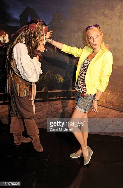 Camilla Dallerup and Captain Jack Sparrow attend an exclusive launch event for upcoming videogame 'Disney Infinity', released nationwide on August...