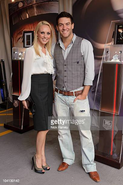 Camilla Dallerup and Kevin Sacre attend the 150th anniversary party of TAG Heuer at Selfridges on September 15 2010 in London England