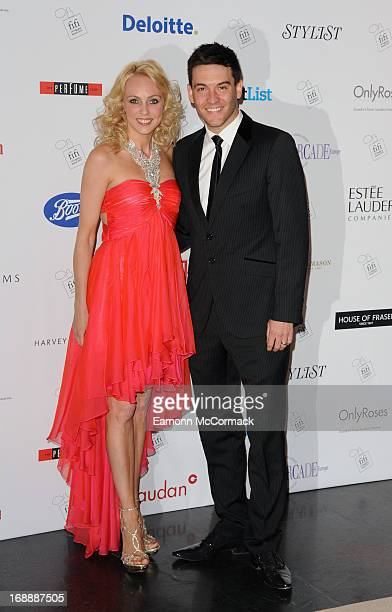 Camilla Dallerup and Kevin Sacre attend the FiFI UK Fragrance awards at The Brewery on May 16 2013 in London England
