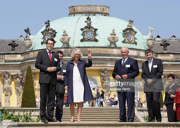 Camilla Duchess of Cornwall accompanied by Hartmut Dorgerloh Director of the Foundation of Prussian Palaces and Gardens and Jann Jakobs Mayor of...