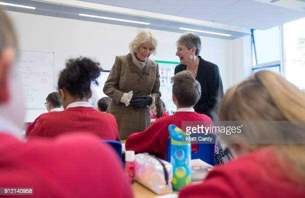 Camilla Duchess of Cornwall accompanied by head teacher Anne Schwodler talks with pupils as she visits Marlborough St Mary's Church of England...