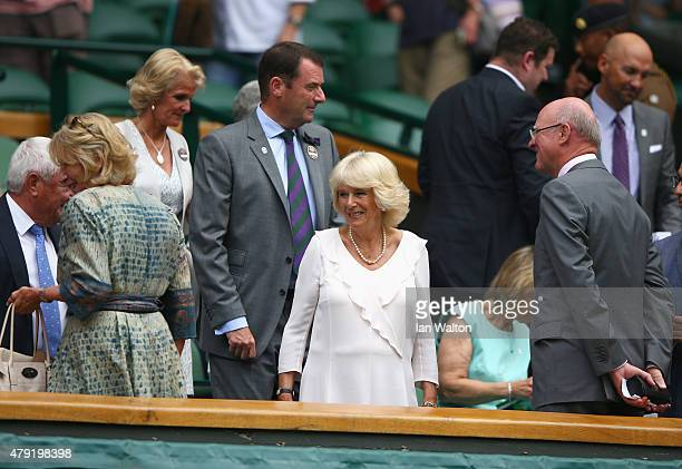Camilla Duchess of Cornwall and AELTC Chairman Phiip Brook take their seat on Centre Court during day four of the Wimbledon Lawn Tennis Championships...