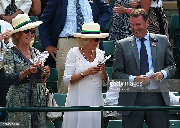 Camilla Duchess of Cornwall and AELTC Chairman Philip Brook look on from Centre Court during day four of the Wimbledon Lawn Tennis Championships at...