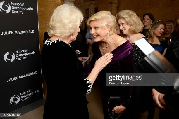 Camilla Duchess of Cornwall and Angela Rippon attend the Julien Macdonald Fashion Show for National Osteoporosis Society at Lancaster House on...