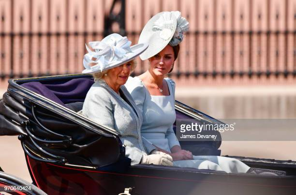 Camilla Duchess Of Cornwall and Catherine Duchess of Cambridge leave Buckingham Palace in a carriage during the Trooping the Colour parade on June 9...