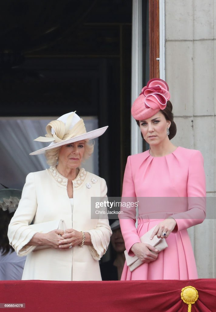 Camilla, Duchess of Cornwall and Catherine, Duchess of Cambridge look out from the balcony of Buckingham Palace during the Trooping the Colour parade on June 17, 2017 in London, England.